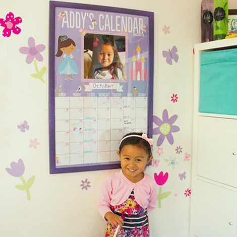 girl with dry-erase poster calendar