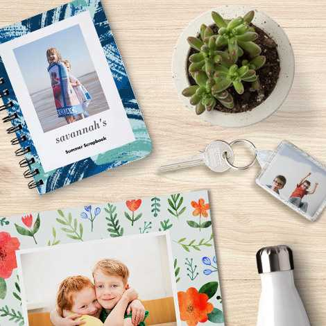 An image containing a spiral book, Photo Acrylic Keyring, bottle and other items.