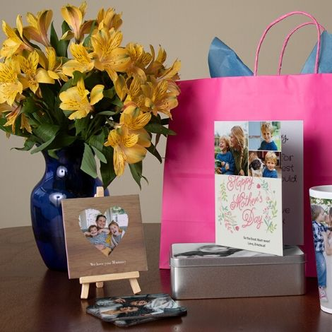 tables with gifts, gift bag and vase with flowers